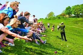 Easter Monday In some areas ›egg rolling‹ is still popular today. People  take the eggs to the top of a hill and roll them down. The first egg to get  to the